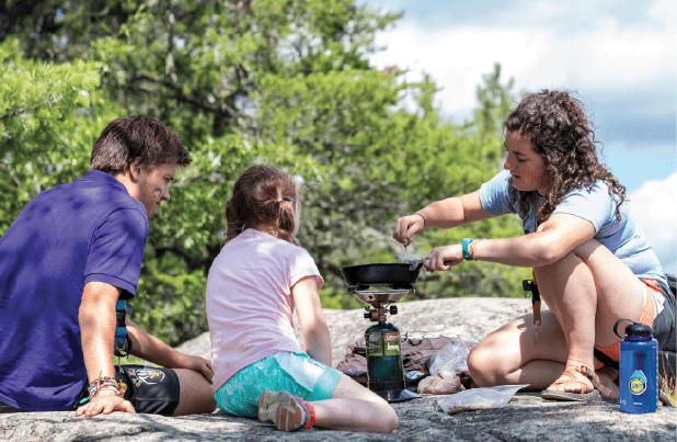Campers at YMCA Camp du Nord learn the essential skill of cooking in the wilderness. All photos courtesy YMCA Camp du Nord.