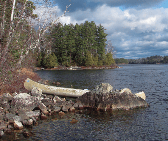 Sigurd Olson's canoe on the shores of Gaul Island. Photo by William M. Steigerwaldt.