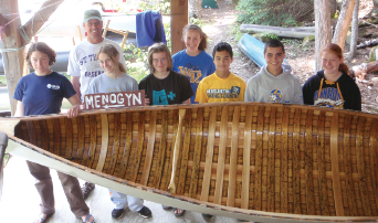 Groups that come to Camp Menogyn learn about wood canvas canoes in Mengoyn's own 'York Factory' canoe shop. Photo courtesy of Camp Menogyn.