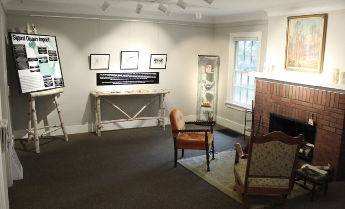 The living room has been adapted to display information about Sigurd Olson's books and conservation work, as well as a nice spot to read one of his books.