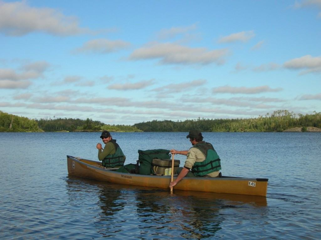Volunteer Thompson Blodgett (bow) and ranger Curt McEwen paddle on Ensign Lake.