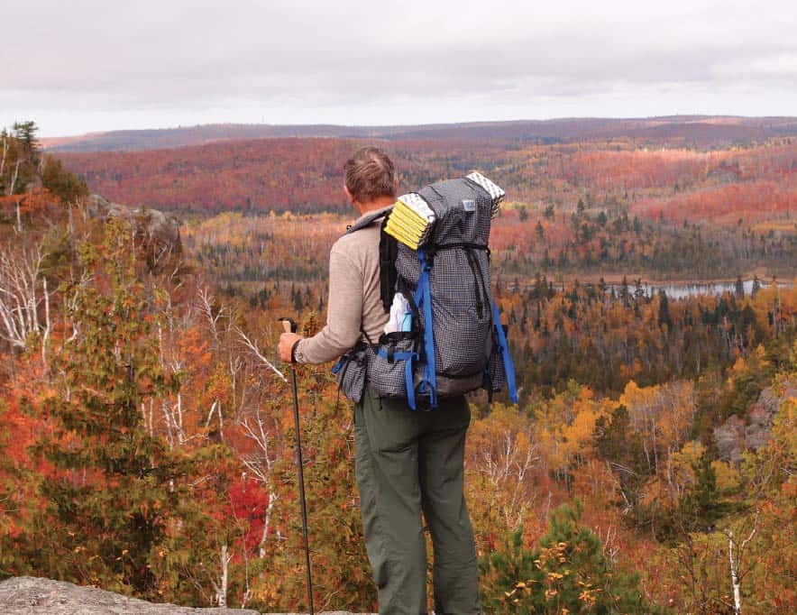 Admiring an autumn view on the Superior Hiking Trail near Finland. Photo by Dave Noll.