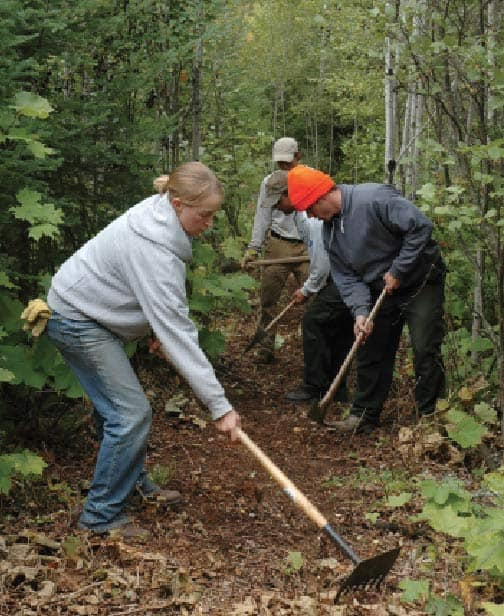 Volunteers use tools called McLeods to clear the tread on the Superior Hiking Trail. Photo by Mark VanHornweder, courtesy Superior Hiking Trail Association.