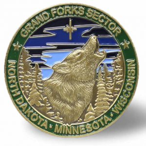 """A """"Challenge Coin"""" for the U.S. Border Patrol's sector which includes the BWCAW features a wolf."""