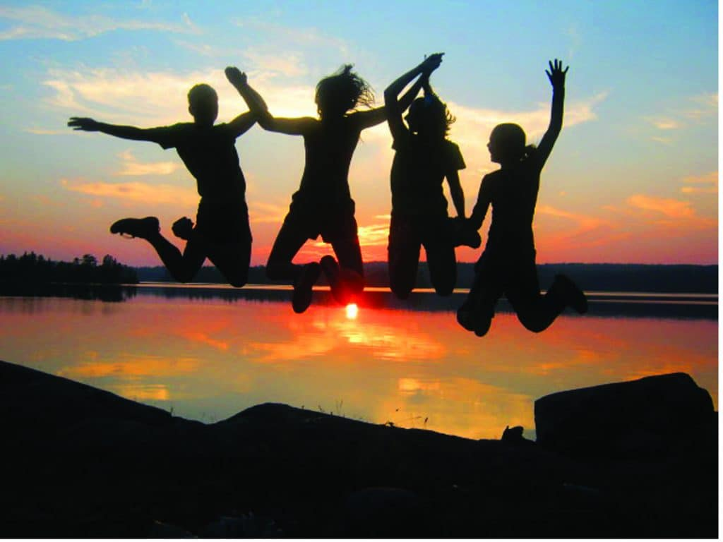 A group of Bold & Gold girls jump for joy. Photo courtesy YMCA Twin Cities.