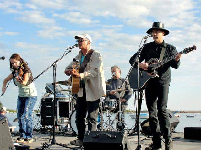 Jerry and The One Match Band playing at the Grand Marais Fisherman's Picnic with Lake Superior in the background. Photo courtesy Jerry Vandiver.